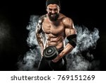 Small photo of Muscular young fitness sports man workout with dumbbell in fitness gym