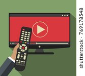 hand holding remote control. tv ... | Shutterstock .eps vector #769178548