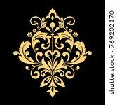 golden pattern on a black... | Shutterstock . vector #769202170