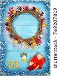 christmas beautiful wreath on a ... | Shutterstock . vector #769207819