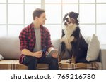 young person with dog at home... | Shutterstock . vector #769216780