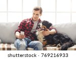 young person with dog at home... | Shutterstock . vector #769216933