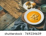 fall warming pumpkin cream soup ... | Shutterstock . vector #769234639