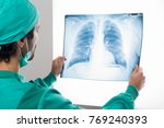 surgeon analyzing a lung... | Shutterstock . vector #769240393