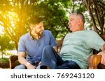 dad and son having fun in the... | Shutterstock . vector #769243120