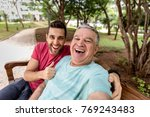 great moment of a dad and son... | Shutterstock . vector #769243483