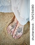 Bride Painting Henna On Foots...