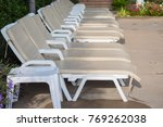 sunbeds to relax by the pool... | Shutterstock . vector #769262038