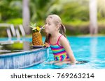 child drinking juice in... | Shutterstock . vector #769263214