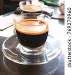 Small photo of a cup of hot americano or hot coffee