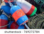 Colorful Lobster Buoys Sit...
