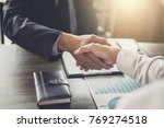 meeting and greeting concept ... | Shutterstock . vector #769274518