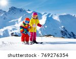 child skiing in the mountains.... | Shutterstock . vector #769276354