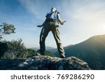 successful female backpacker... | Shutterstock . vector #769286290