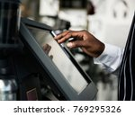 cashier working on sales | Shutterstock . vector #769295326
