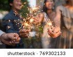 burning sparklers in hands of...   Shutterstock . vector #769302133