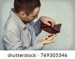 coins and an empty wallet. poor ... | Shutterstock . vector #769305346