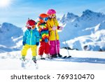 child skiing in the mountains.... | Shutterstock . vector #769310470
