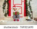 funny girl child gnome in santa ... | Shutterstock . vector #769321690