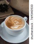 coffee cup latte art | Shutterstock . vector #769340533