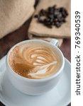 coffee cup latte art | Shutterstock . vector #769340539