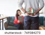 young asian man holding gift... | Shutterstock . vector #769384273