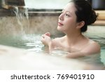 happy young woman relaxing in...   Shutterstock . vector #769401910