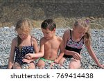siblings have fun time on the... | Shutterstock . vector #769414438