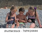 siblings have fun time on the... | Shutterstock . vector #769414444