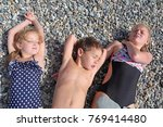 siblings have fun time on the... | Shutterstock . vector #769414480