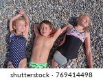 siblings have fun time on the... | Shutterstock . vector #769414498