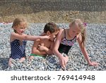 siblings have fun time on the... | Shutterstock . vector #769414948