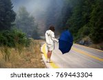 young female in a raincoat and... | Shutterstock . vector #769443304