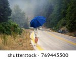 young female in a raincoat and... | Shutterstock . vector #769445500