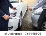 insurance agent writing on... | Shutterstock . vector #769445908