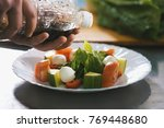 chef serves salad on the plate... | Shutterstock . vector #769448680