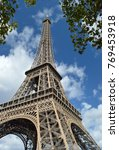 eiffel tower against a blue sky. | Shutterstock . vector #769453918