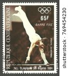 Small photo of Central African Republic - stamp printed 1984, Multicolor Air Mail issue, Topic Athletics, Series 1984 Olympic Games Los Angeles, Barre fixe