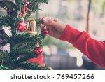 Woman Holding Xmas Ornament....