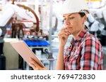 female engineer using tablet... | Shutterstock . vector #769472830