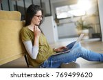 trendy woman relaxing at home... | Shutterstock . vector #769499620