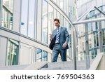 businessman walking downstairs... | Shutterstock . vector #769504363