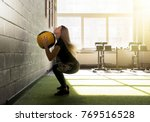 woman doing exercise with heavy ... | Shutterstock . vector #769516528