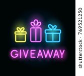 neon giveaway card with gift... | Shutterstock .eps vector #769521250