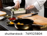 cooking food. the hands of the...   Shutterstock . vector #769525804