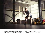 man with battle ropes in gym | Shutterstock . vector #769527130