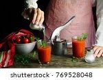 the girl prepares tomato juice... | Shutterstock . vector #769528048