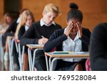 anxious teenage student sitting ... | Shutterstock . vector #769528084