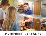 teenage students being served... | Shutterstock . vector #769532743