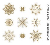 set of gold snowflakes.... | Shutterstock .eps vector #769554670